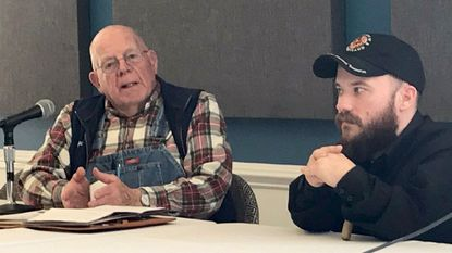 """Churchville farmer Lawrason Sayre, left, speaks during a panel discussion at the """"Food, Farmers and Community: Opening the Dialogue"""" symposium at Harford Community College Saturday. He is with Andy Kness of the University of Maryland Agricultural Extension."""