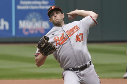 Baltimore Orioles starting pitcher John Means throws against the Seattle Mariners during the seventh inning of a baseball game, Wednesday, May 5, 2021, in Seattle. He threw a no-hitter.(AP Photo/Ted S. Warren)