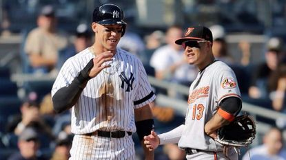Yankees outfielder Aaron Judge, left, talks with Orioles third baseman Manny Machado during the eighth inning of a Septmber game at Yankee Stadium.