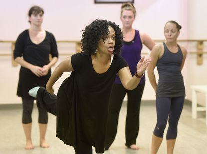 "Donna Jacobs, of Ellicott City, director of Full Circle Dance Company, leads a rehearsal of ""A Woman's Place: Purpose, Passion, Power,"" which the company will perform Nov. 5 and 6 at Slayton House Theatre in Columbia."