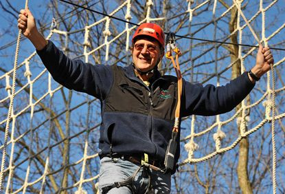 Matt Baker, owner of Terrapin Adventures, climbs on the The High Ropes Challenge Course.