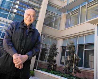 Paul Terasaki, in 2010, in front of the Terasaki Life Sciences Building at UCLA.