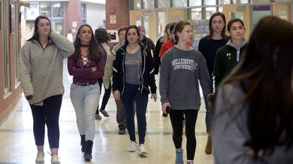 Century High School students walk out of class on March 14 in conjunction with the National School Walkout honoring the victims who died a month earlier at a shooting in Parkland, Fla.