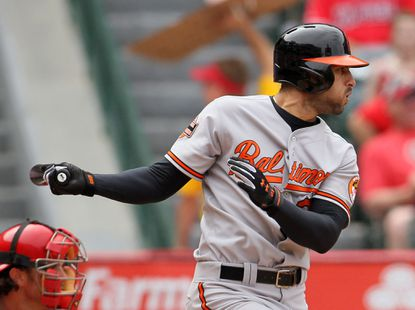 Nick Markakis singles to left field to drive in two runs in the eighth inning against the Angels. Markakis had his third RBI in the 10th to give the O's a 3-2 win.