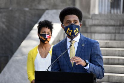 Baltimore Mayor Brandon Scott holds a news conference to announce the continuation of Covid restrictions in the city. Baltimore Health Commissioner Dr. Letitia Dzirasa is on left. March 12, 2021