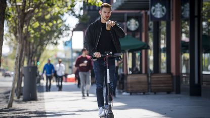 A person rides a Bird electric scooter in San Francisco. The startup fleet has launched in Baltimore.