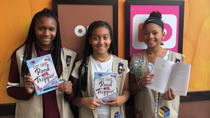 Kendall Hamilton, Lexie Brinkley, and Tori Keys see their book, East Coast Road Trippin, in print for the first time at the Sept. 22 book reveal held at Dunkin Donuts in Hanover.