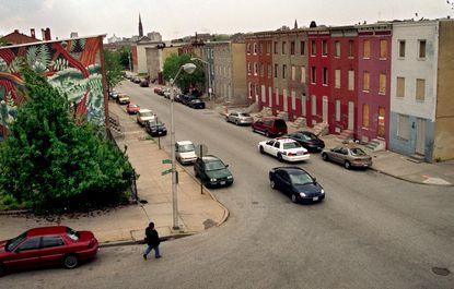 Baltimore's many neighborhoods are divided up into how many geographical regions?