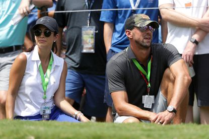 Michael Phelps and his wife, Nicole Johnson, look on Thursday during the first round of the 2017 PGA Championship at Quail Hollow Club in Charlotte, N.C.