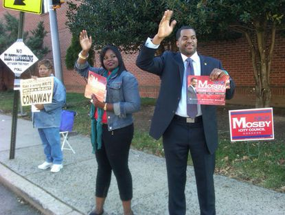 From left, Mary Conaway, mother of write-in candidate for City Council Belinda Conaway, Destynee Bright, niece of council candidate Nick Mosby, and Mosby himself campaign at Dr. Nathan A. Pitts/Ashburn Elementary Middle in Baltimore's Ashburn neighborhood.