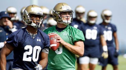 Quarterback Zach Abey drops back during a walk through. Navy football held their first practice of the 2017 season at the academy.