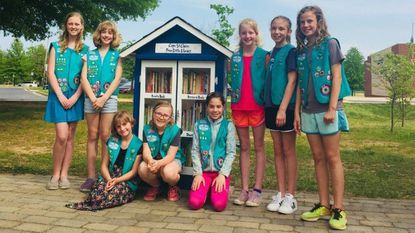 Girl Scout troop 1566 at the opening of the Little Free Library May 10 at Cape St. Claire Elementary School. From left to right are: Kenzie Moyer, Abby Chapman, Alisha Donahue, Casey Fitzpatrick, Nadia Smith, Lyla Young, Abby Glasser and Summer Stroop