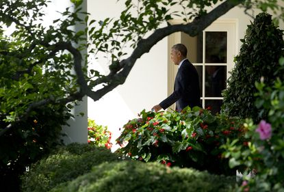 President Barack Obama, walks along the Colonnade from the Oval Office of the White House in Washington, Wednesday, Sept. 9, 2015, for a trip to Warren, Mich. Obama is teaming up with Dr. Jill Biden, the wife of the vice president and a community college teacher, to visit Macomb County Community College in Warren, Mich., on Wednesday. They planned to announce an independent College Promise Advisory Board, led by Biden, that will highlight existing programs providing free community college. (AP Photo/Manuel Balce Ceneta) ORG XMIT: WHMC106
