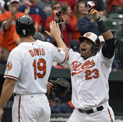 Chris Davis, left, congratulates teammate Nelson Cruz at home plate after his three-run homer in the fifth inning of a May loss to Detroit.