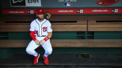 Washington Nationals right fielder Bryce Harper looks on from the bench during the Nationals' final home game of the 2018 season on Sept. 26.
