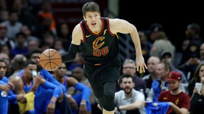 The Cavaliers' Kyle Korver drives against the Thunder in the first half of a game in Cleveland. As he tries to focus on basketball, Cleveland's forward is grieving from the recent tragic death of his youngest brother, Kirk, who died at 27.