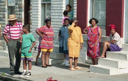 Neighbors watch as firefighters work a one-alarm fire at 2424 Eager Street on July 7, 1992. Six of Tonya Lucas' seven children died and she was charged with setting the fire. (Amy Davis/Baltimore Sun)