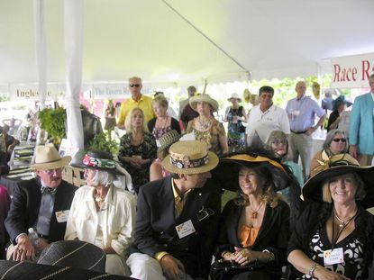 Patrons attend the annual Preakness party at Rappahannock Community College in Warsaw, Va.