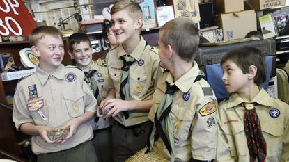 Members of Boy Scout Troop 380 wait to display items being auctioned to benefit the troop at Snyder's Auction House in Hampstead in 2015. This year's auction is set for Saturday, March 2 from 9 a.m. until 5 p.m. at Snyder's Auction House.