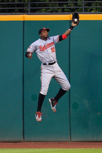 Baltimore Orioles' Adam Jones jumps high to catch a fly ball hit by Cleveland Indians' Shin-Soo Choo in the fifth inning in a game on Monday in Cleveland.