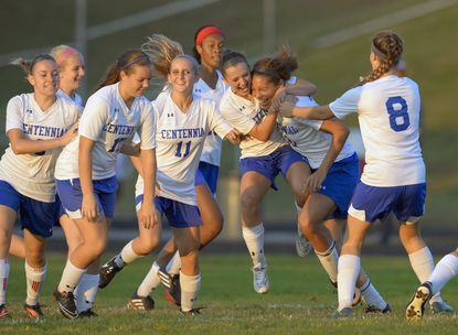 Centennial's girls soccer team, seen here celebrating a goal in this file photo, defeated Glenelg on Tuesday, 3-1.
