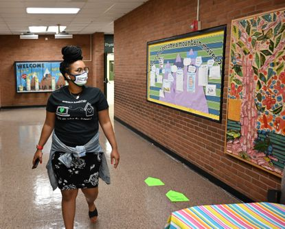 New Magnolia Elementary School teacher Monique Hawkes takes a little time to get familiar with the building as she takes a stroll through the halls Thursday morning.