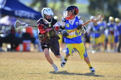 A Crabs Atlantic Stars player, right, vies with an L.A. Lazers player at the 12th annual Adrenaline Challenge in Del Mar, Calif. The Stars went undefeated to win their middle school bracket age bracket.