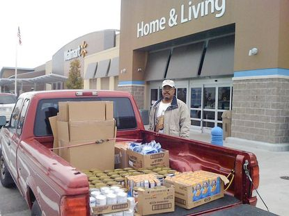 Dwight D. Eisenhower Middle School PTSA president Ron Dortch organized a food drive with Walmart to help feed families in the area for Thanksgiving.