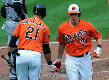 Nick Markakis congratulates Taylor Teagarden on his solo home run in the third inning Thursday afternoon.