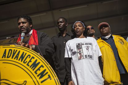 """The Rev. William Barber II calls for justice for Lennon Lacy at a rally in the PBS documentary """"Always in Season."""" Andrew Craft photographer. Licensed from Peter Eversoll."""