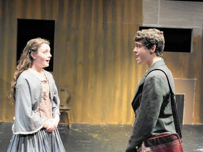 """Jo, left, played by Mallorie Stern, reacts to a proposal by Professor Bhaer, played by Jack Del Nunzio, in Century High School's production of """"Little Women."""" Stern and Del Nunzio are both seniors at the school."""