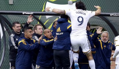 Los Angeles Galaxy forward Alan Gordon jumps in the arms of teammates after scoring a goal in extra time to tie the game against the Portland Timbers on Sunday.
