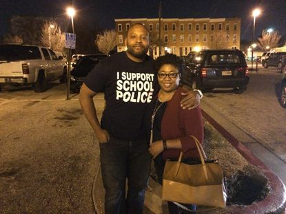 Baltimore school police officer Kelley Jackson, left, stands beside Muriel Cole-Webber, principal of Edmondson-Westside High School outside a meeting Tuesday of the city school board. School administrators attended Tuesday's meeting as a show of support for school police.