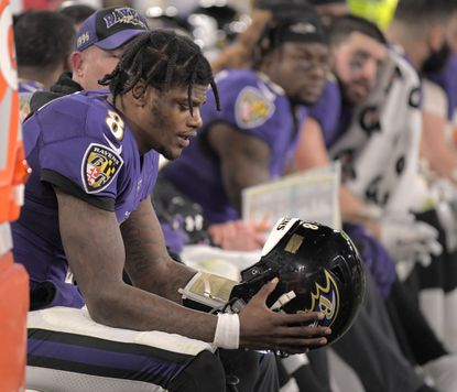 Baltimore Ravens quarterback Lamar Jackson sits on the bench as the Ravens playoff hopes fade in the fourth quarter against the Tennesse Titans in the AFC Division Playoffs at M&T Bank Stadium in Baltimore on Saturday, Jan. 11, 2020. The Titans advanced, 28-12.
