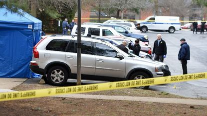 Detectives and crime scene technicians investigate the Feb. 7, 2017 shooting death of Marilyn Jaz Scott outside the Calvert's Walk Apartments in Bel Air South, one of eight Harford County homicides since 2013 that remain unsolved.