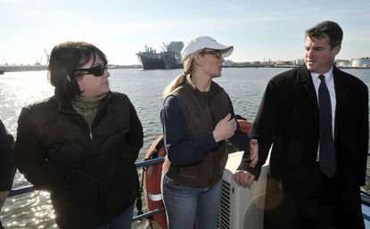(From left) Halle Va de Gaag, executive director of Blue Water Baltimore, and Eliza Smith Steinmeier, Baltimore City Waterkeeper, talk Tuesday with Maryland Attorney General Doug Gansler about the water quality of the Inner Harbor and some of the issues confronting cleanup as they cruise aboard the M/V Port Endeavor.