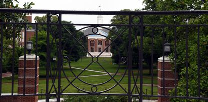 The Wyman Quad as viewed through a wrought iron feature on the Johns Hopkins University Homewood campus. June 11, 2020