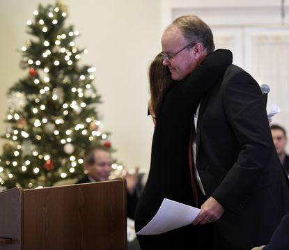 Tom Welliver is congratulated by Missie Wilcox before accepting the 2019 Sylvia V. Canon Humanitarian Award at Carroll Lutheran Village in Westminster Wednesday, Dec. 11, 2019.