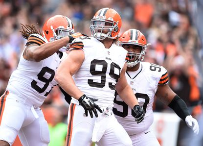 Paul Kruger celebrates his sack with Billy Winn and Jabaal Sheard of the Cleveland Browns.