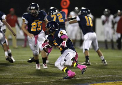 Catonsville's Brian Taylor helped the ground game on offfense and his three interceptions on defense led the Comets to a 20-8 win over Woodlawn.