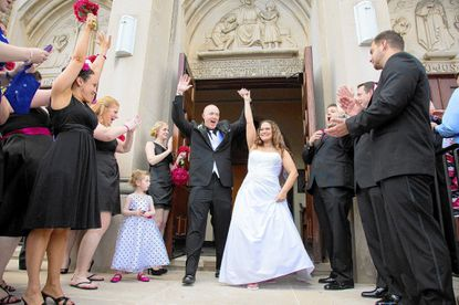 Michele Huffman and Larry Mueller were married at the Shrine of the Little Flower Roman Catholic Church