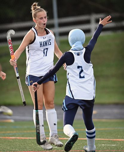 River Hill's Claire Slade, left, celebrats her goal against Marriotts Ridge with teammate Jannah Nassar, right, in the first quarter of field hockey game on Sept. 20, 2021.