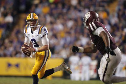 LSU quarterback Joe Burrow (9) scrambles in the second half of an NCAA college football game against Texas A&M in Baton Rouge, La., Saturday, Nov. 30, 2019. LSU won 50-7. (AP Photo/Gerald Herbert)