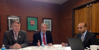 Howard County Executive Allan Kittleman, left, Spending Affordability Committee Chairman Steve Sachs, center, and Deputy Chief of Staff Jahantab Siddiqui meet for a briefing on the Spending Affordability Committee's annual report, released March 2.
