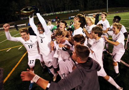 McDonogh celebrates the win after the MIAA A Conference Boys Soccer Championship between McDonogh and Archbishop Curley.