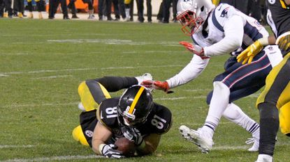 This apparent touchdown catch by Steelers tight end Jesse James on Sunday was overturned, and the New England Patriots escaped Pittsburgh with a 27-24 win. Ravens quarterback Joe Flacco said the right call was made.