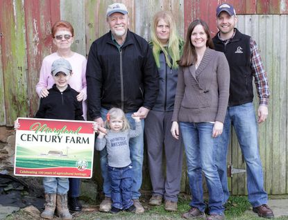 The owners of the The Wil-Low-S at Lowe Point farm in Pylesville were honored as a Maryland Century Farm Family in Annapolis on Monday. The owners include Ruth Ann Smith, left, and her daughter and son-in-law, Jennifer and Adam Wilson, right. They are with Smith's husband, Ronald, son, Chris and grandchildren, Lillian and Samuel Wilson.