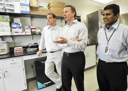 (Left to right) Nick Hammond, chief technology officer; Ken Malone, CEO; and Srinivas Rapireddy, research scientist, talk in Ablitech Inc.'s new lab.