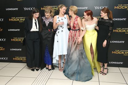 """Musician Lorde, actresses Natalie Dormer, Jennifer Lawrence, Elizabeth Banks, Jena Malone and Julianne Moore get silly during the world premiere of """"The Hunger Games: Mockingjay Part 1"""" in London on Nov. 10, 2014."""
