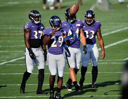 Running backs left to right: BuckAllen, Justin Forsett, Kyle Juszczyk and Stephen Houston during drills at Ravens training camp.